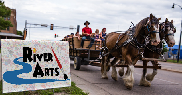 River Arts sign and clydesdales horses