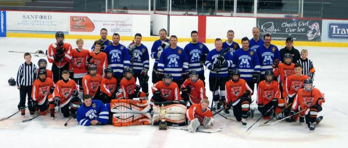 website cops vs kids hockey game
