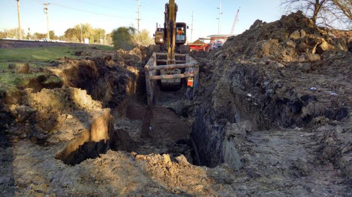 New water main installation by tracks